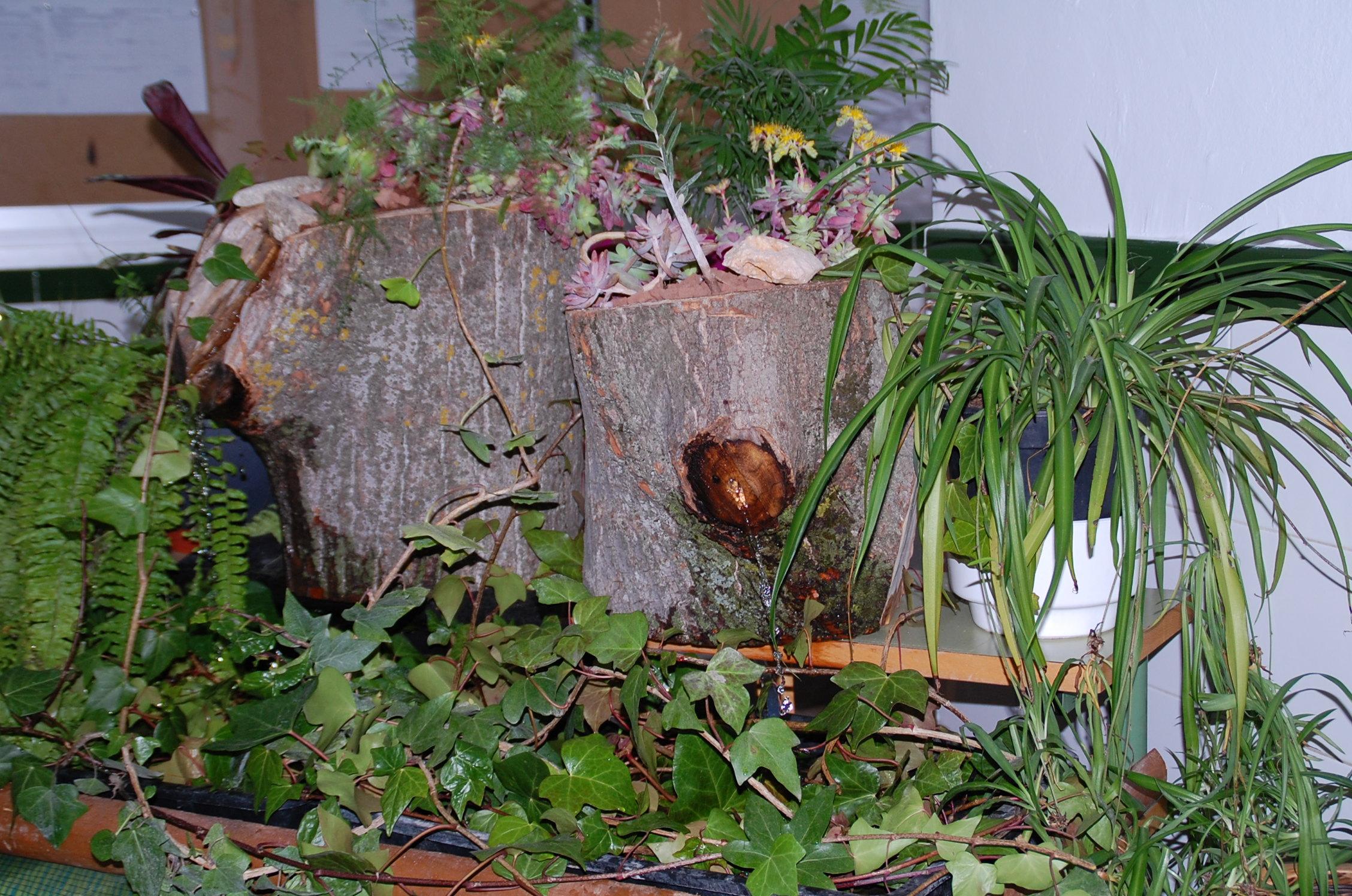 Imagenes de jardines decorados con troncos for Figuras para jardines
